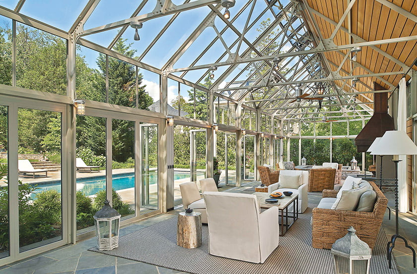 Andrew Law furnished the interior in a neutral palette. Steel trusses are softened by mahogany slats.