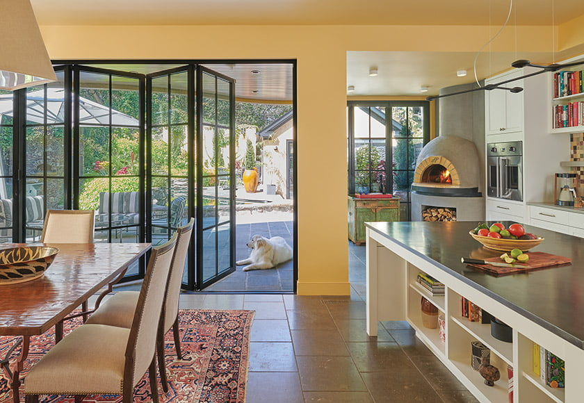A NanaWall opens from the kitchen to the terrace.
