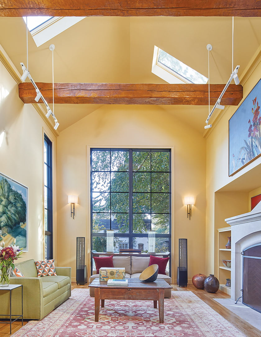 The two-story living room preserves a fireplace and a wooden beam that survived the fire.