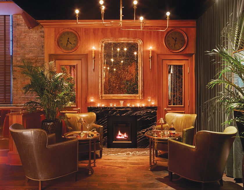 In Monarque's cozy lounge, guests can enjoy drinks and view the stage. Photo: Richard Powers
