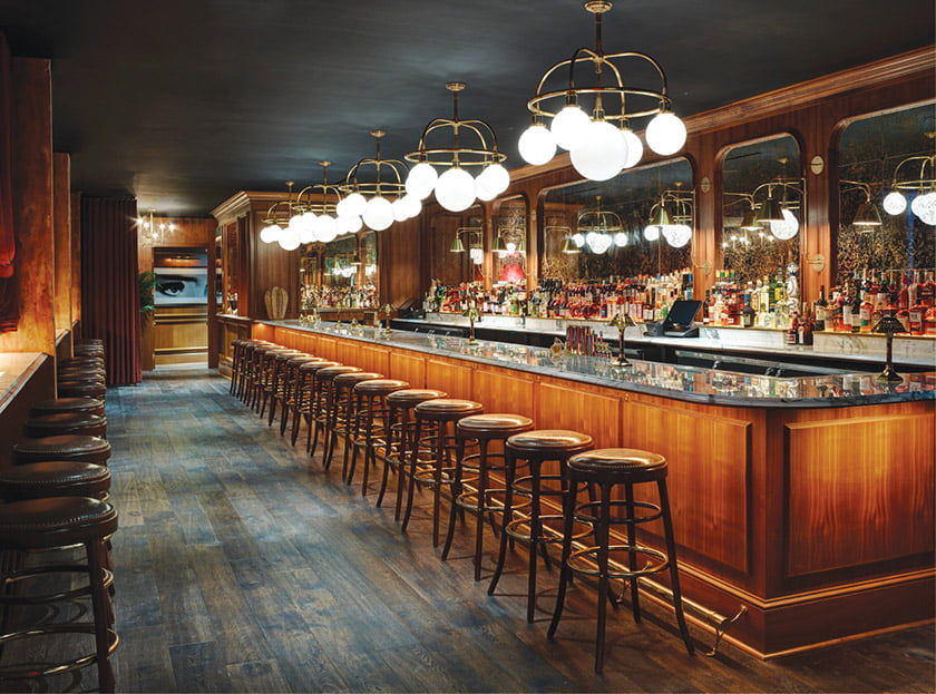 The marble-topped bar is illuminated by fanciful fixtures. Photo: Richard Powers