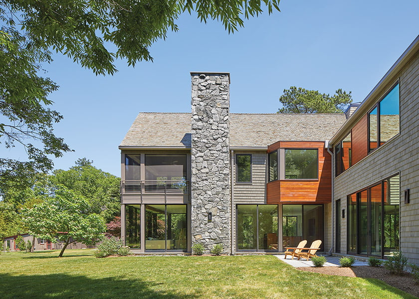 A fieldstone chimney adds drama to the two-story contemporary farmhouse.