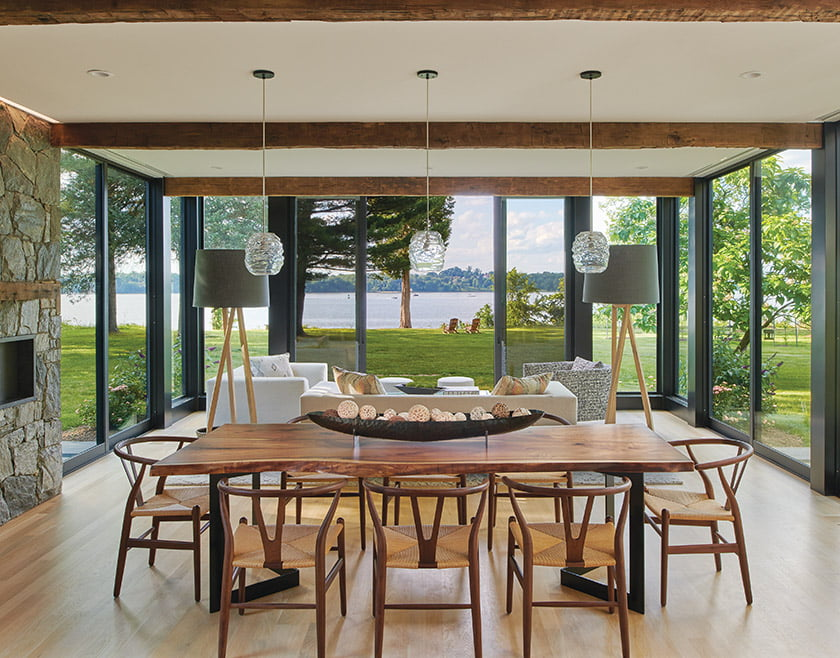 Low-slung furnishings keep the vistas paramount in the living-dining-kitchen space.