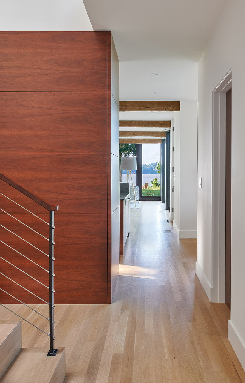 The entranceway offers a through-the-house glimpse of the river.