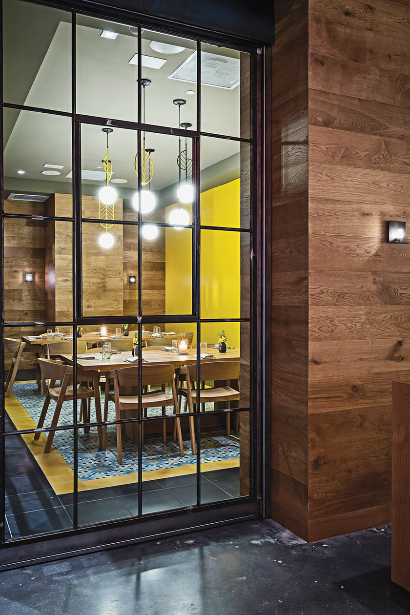 Grupo7 designed the modern interior with distressed-wood paneling and colorful tilework. Photo: Scott Suchman