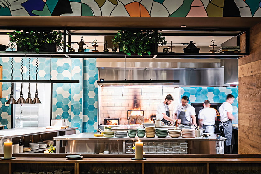 Albi's open kitchen features live fire and a wood-fired pita oven. Photo: Scott Suchman