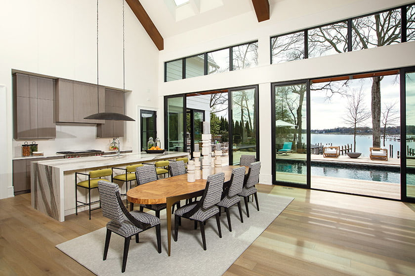 Designed by Joy, the sleek, modern kitchen showcases cabinetry by Quality Cabinets.