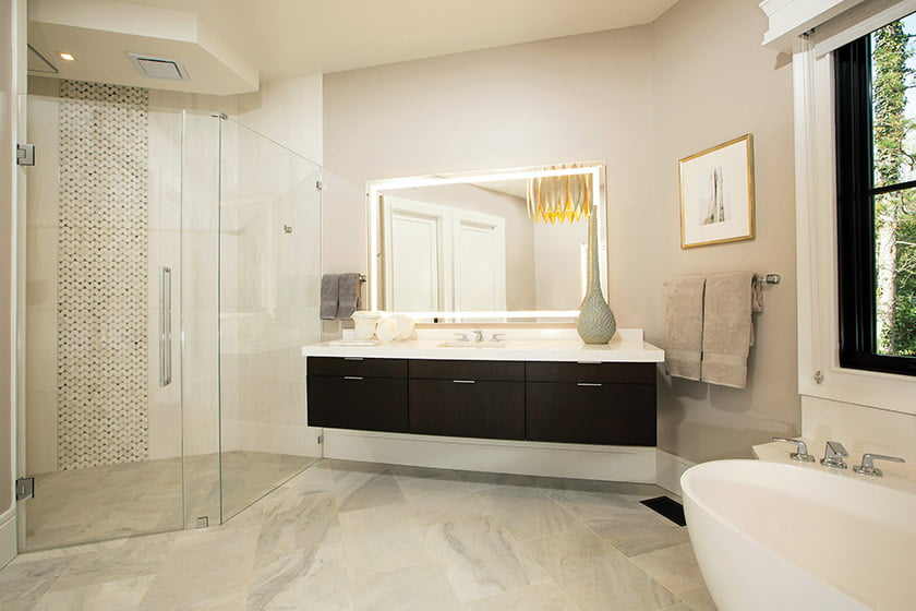 A wall-hung Quality Cabinets vanity is one of two in the owners' bath.