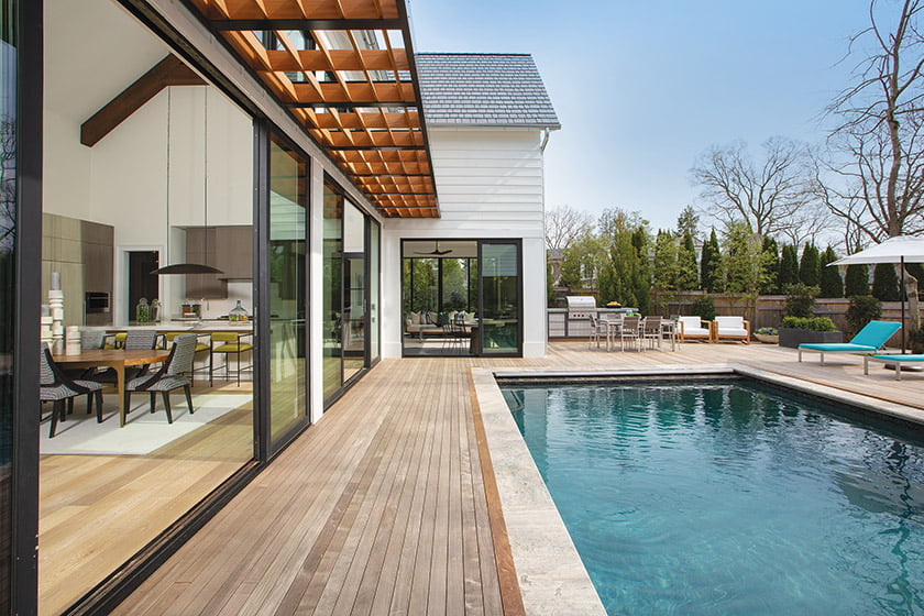 Three sets of sliding doors open from the great room onto the pool deck.