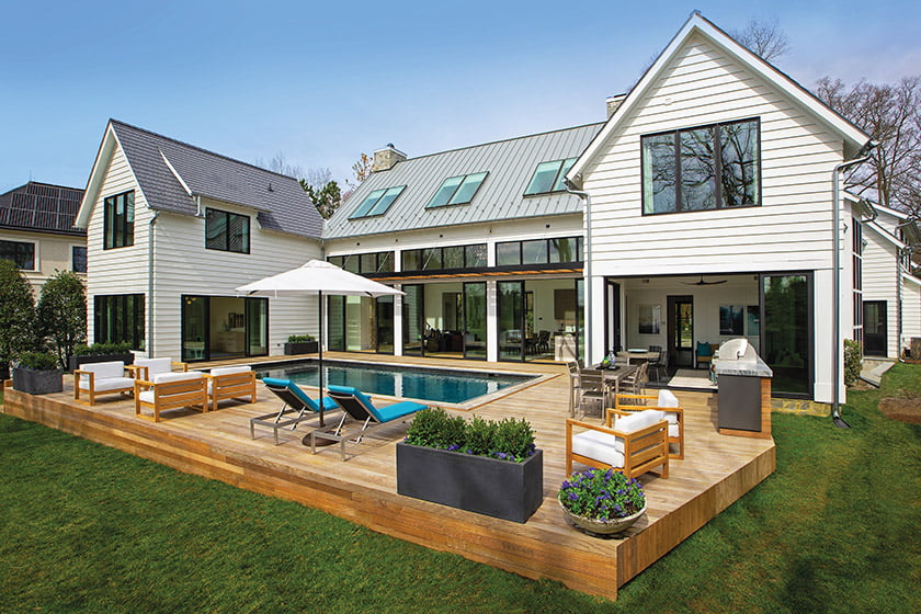 LaCantina sliding-glass doors and windows by Windsor open onto the deck with water views beyond.