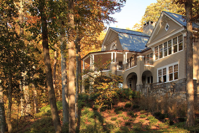 Structural changes include the addition of a roof to a waterfront-facing deck to create a traditional porch.