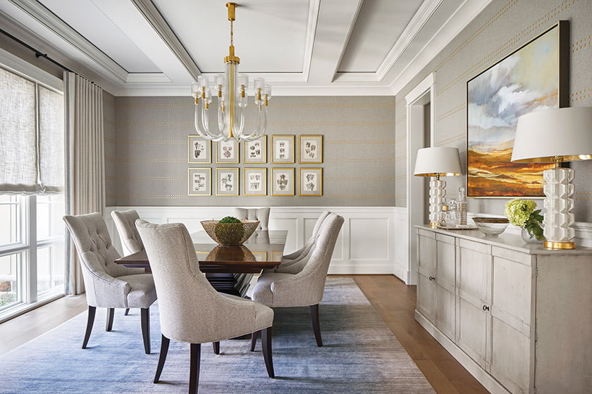 Phillip Jeffries wall covering embellished with gold studs graces the dining room.
