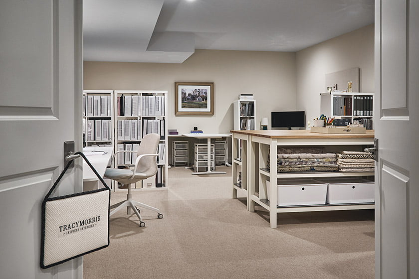 Morris' downstairs studio features workstations and repurposed kitchen islands offering additional work surfaces.