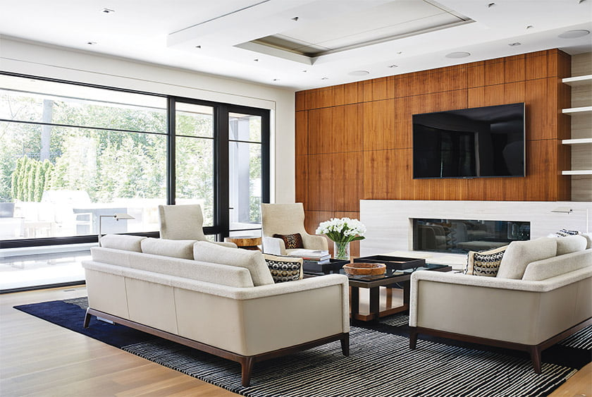 Walnut also clads a wall of built-ins in the sitting area.