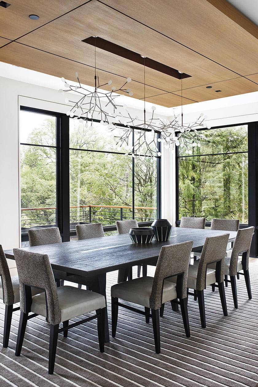 The dining room boasts treetop views.
