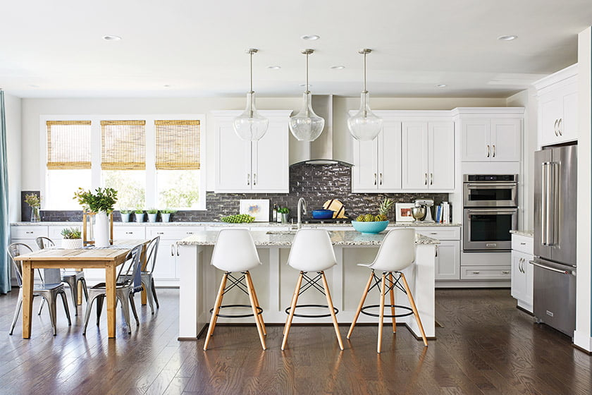 Madison Homes customized the kitchen with quartzite countertops and a reflective-tile backsplash.
