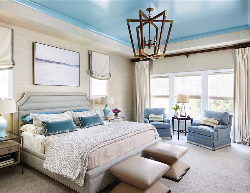 Austin designed the bed and swivel chairs; the chandelier is from Currey & Co.