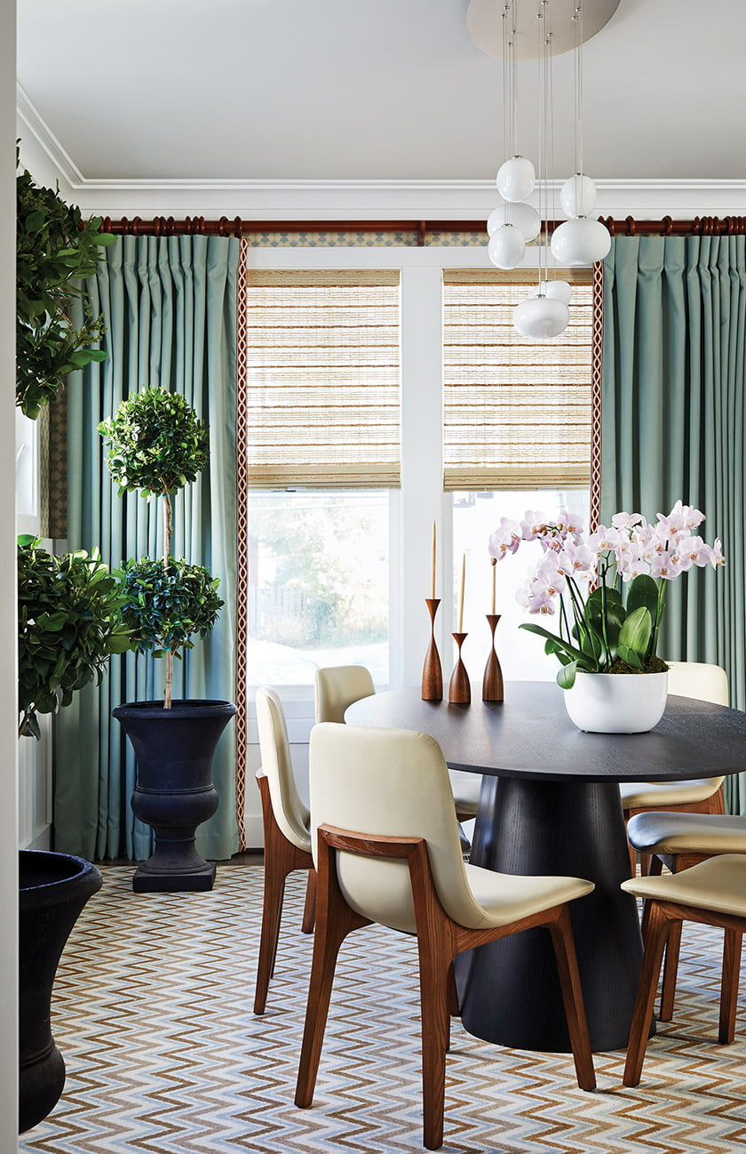 A coastal palette prevails in the dining room
