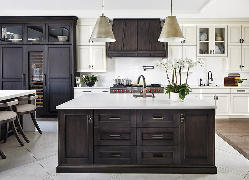 White-painted cabinetry and white Caesarstone countertops are offset by glazed