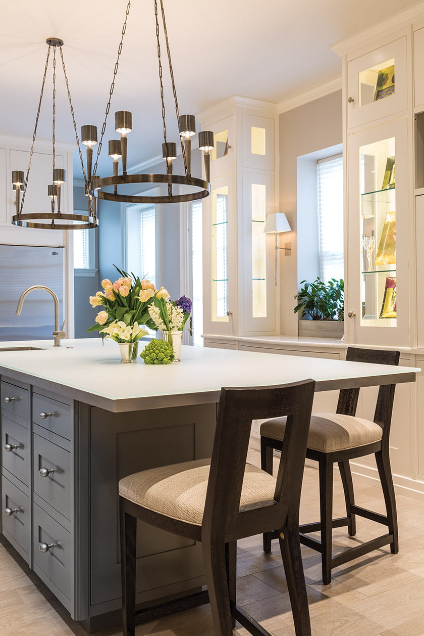 The kitchen island's etched-glass countertop