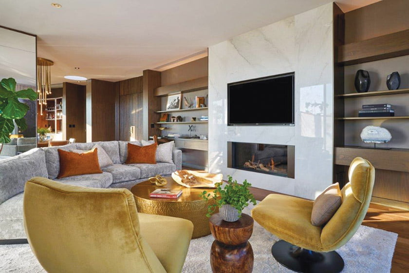 A posh living room with bespoke furnishings designed by Clodagh.