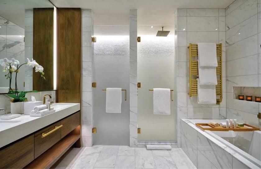 A marble-clad bathroom with a heated floor.
