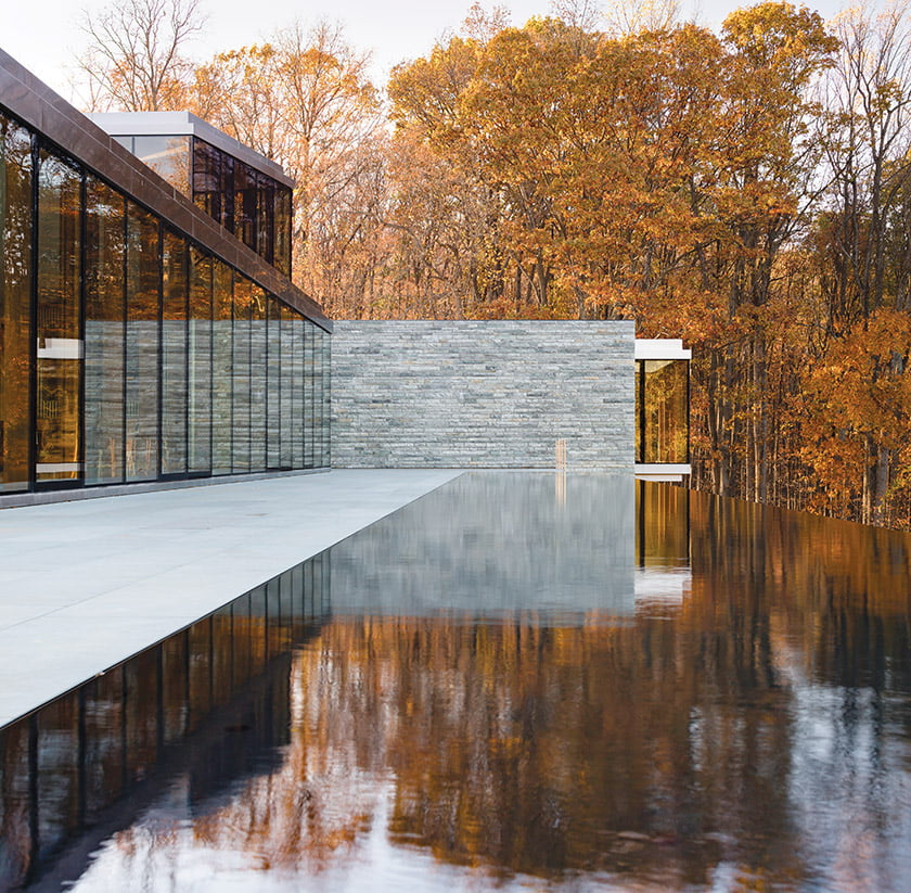 The expanse of glass and pool