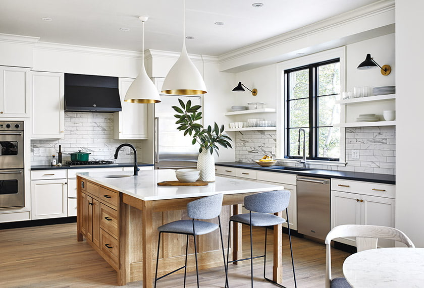 In the revamped kitchen, Benton designed a new natural-wood island with a prep sink;