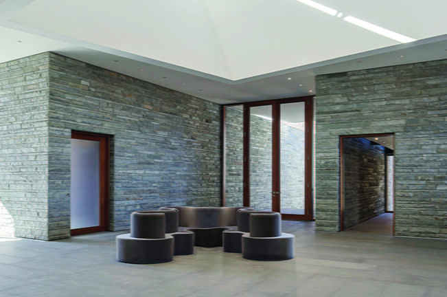Stacked-stone walls define a 1,600-square-foot atrium