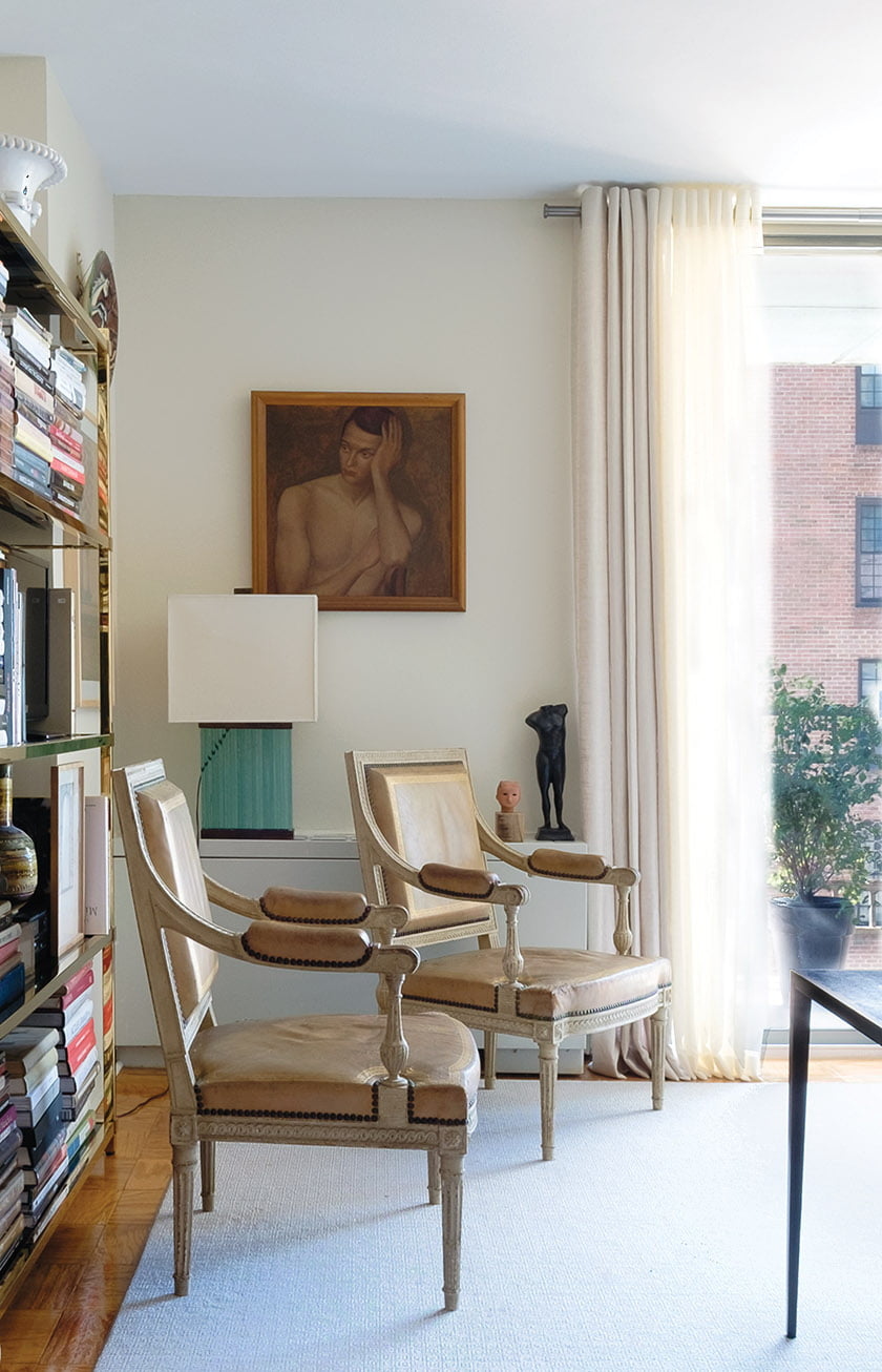 Louis XVI chairs with mid-century pieces in living area
