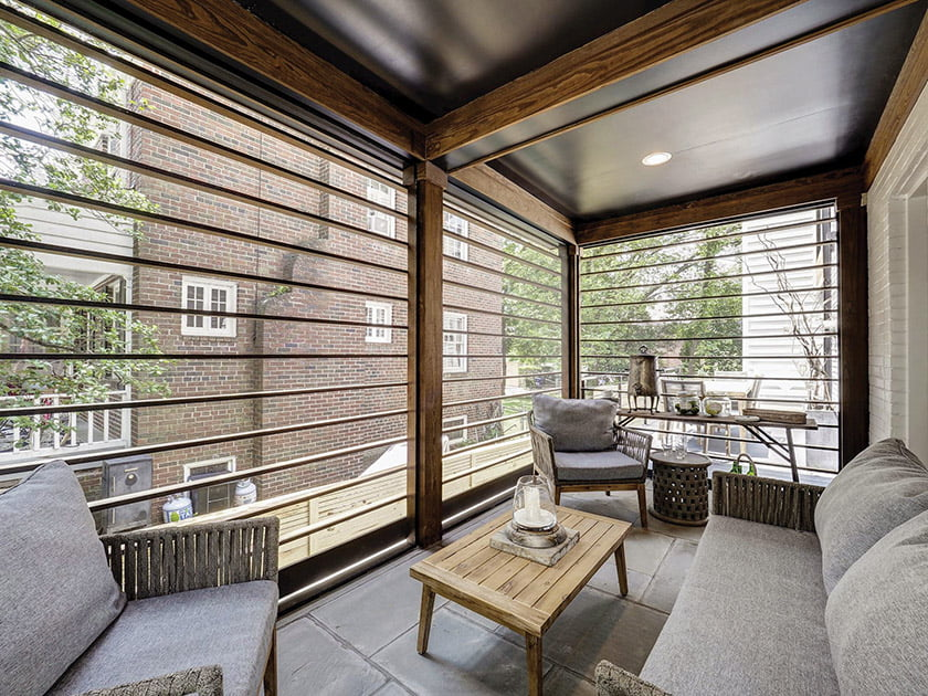 Screened porch with wood slats and exposed beams