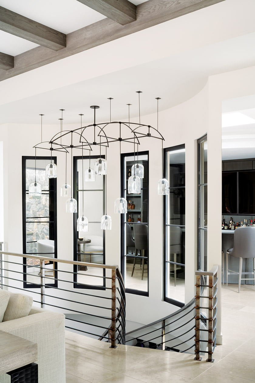 Curved steel staircase with fixture by Alison Berger