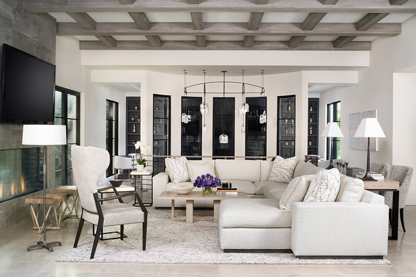 Family with A. Rudin sectional, wingback chair by Gregorius Pineo and Paul Ferrante coffee table