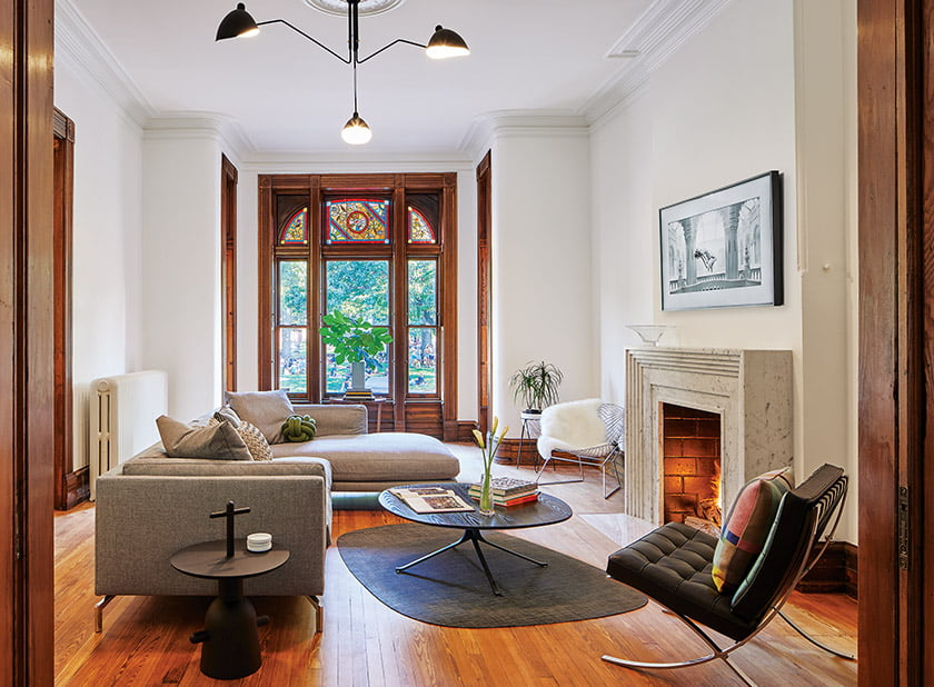 Sleek marble fireplace in living room designed by Healey
