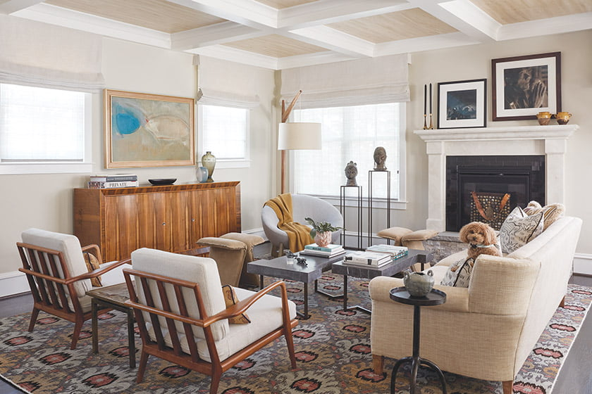 Family room with Mid-Century chairs, vintage French cabinet and Moroccan-style rug