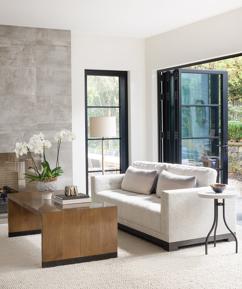 Living room with Gregorius Pineo coffee table, Holland & Sherry rug and Ecocrete fireplace wall