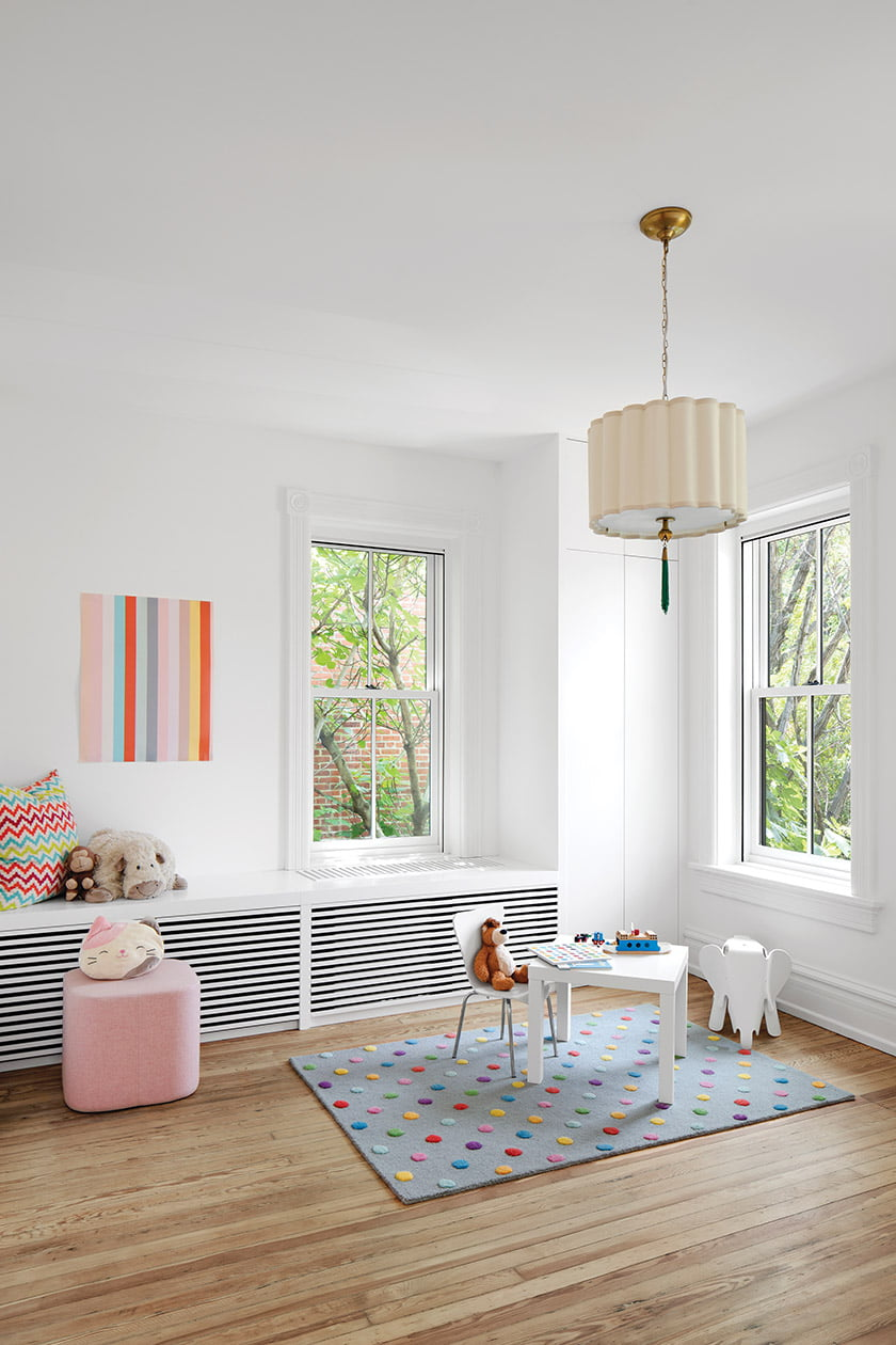 Covered radiator with storage in nursery