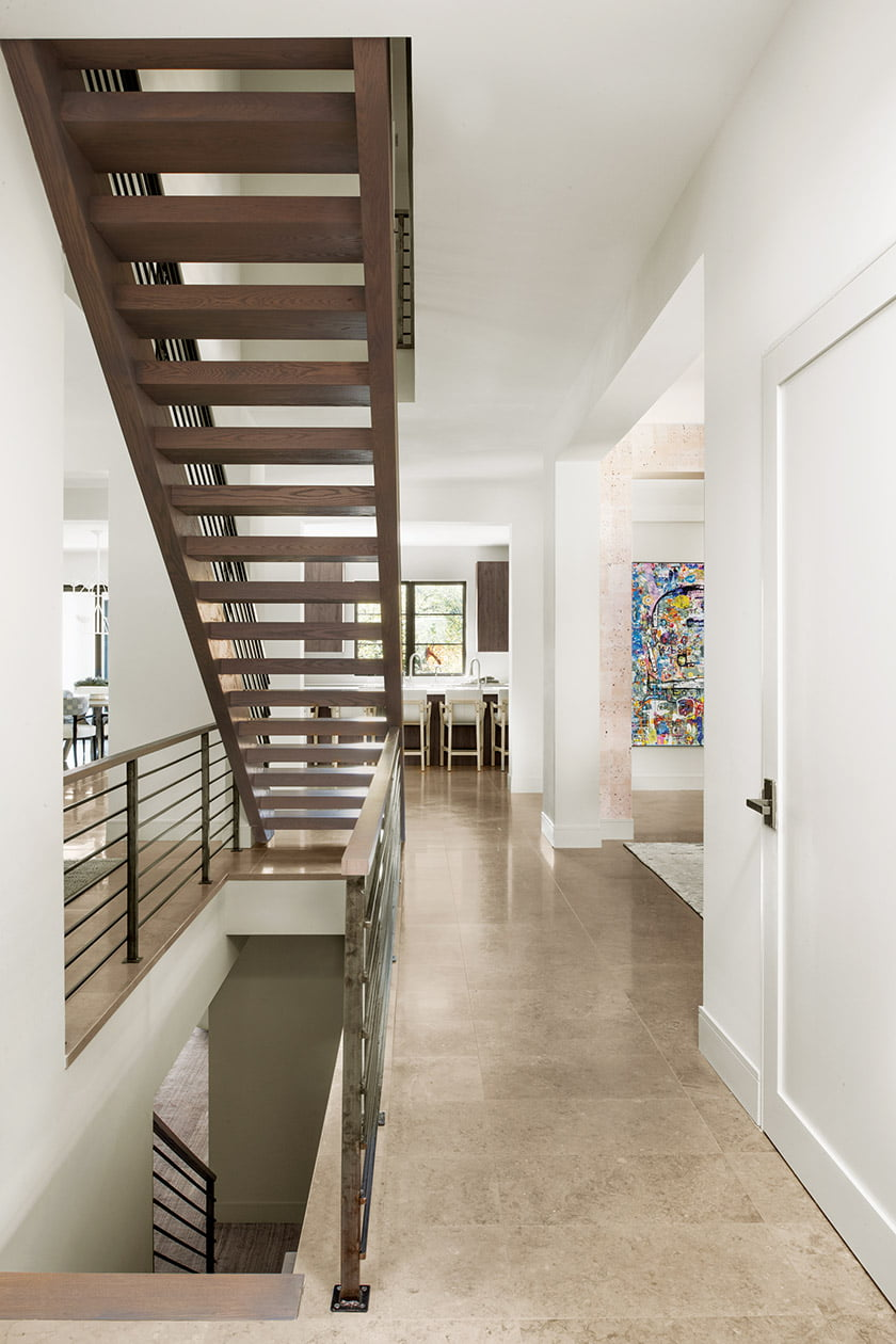 Staircase with a view of kitchen