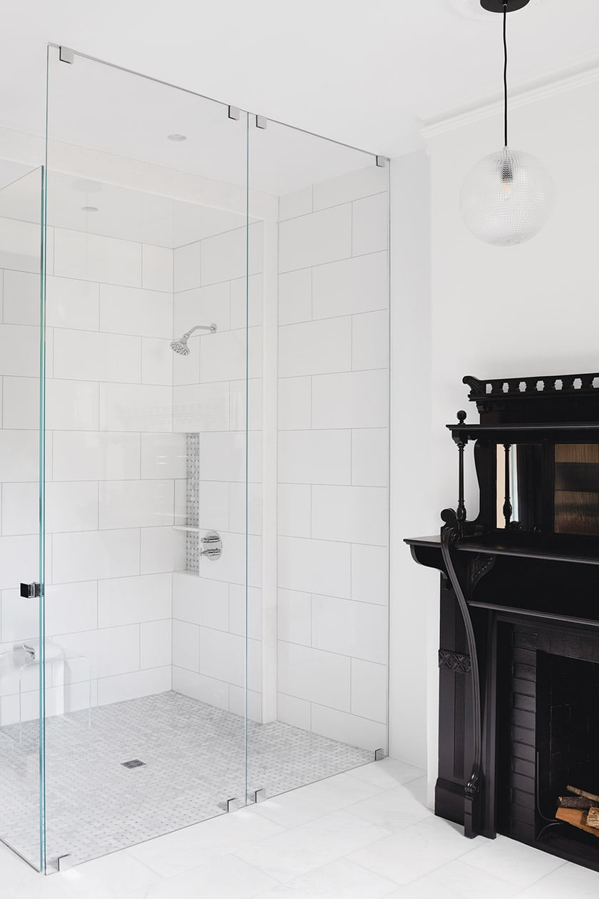 Bath with ornate fireplace