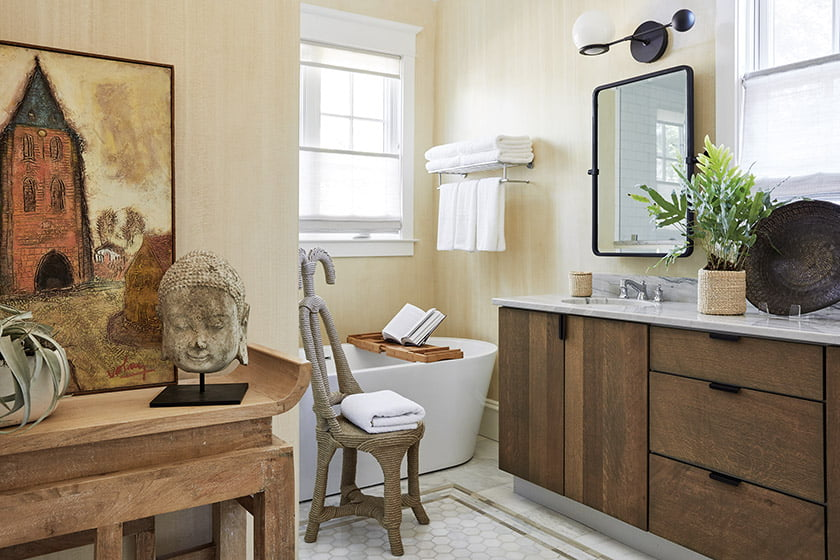 Antique altar table, French painting and a smiling Buddha in owners bath