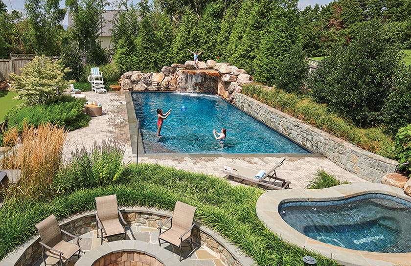 Spa and fire pit flank pool