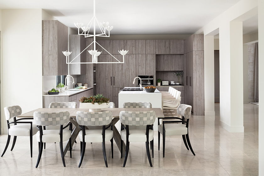 Breakfast area with Paul Ferrante chandelier, Keith Fritz dining table and Holly Hunt chairs