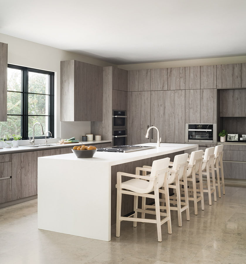 Sleek kitchen designed by Shawna Dillon of Snaidero DC Metro, island with quartz countertops and Holly Hunt stools