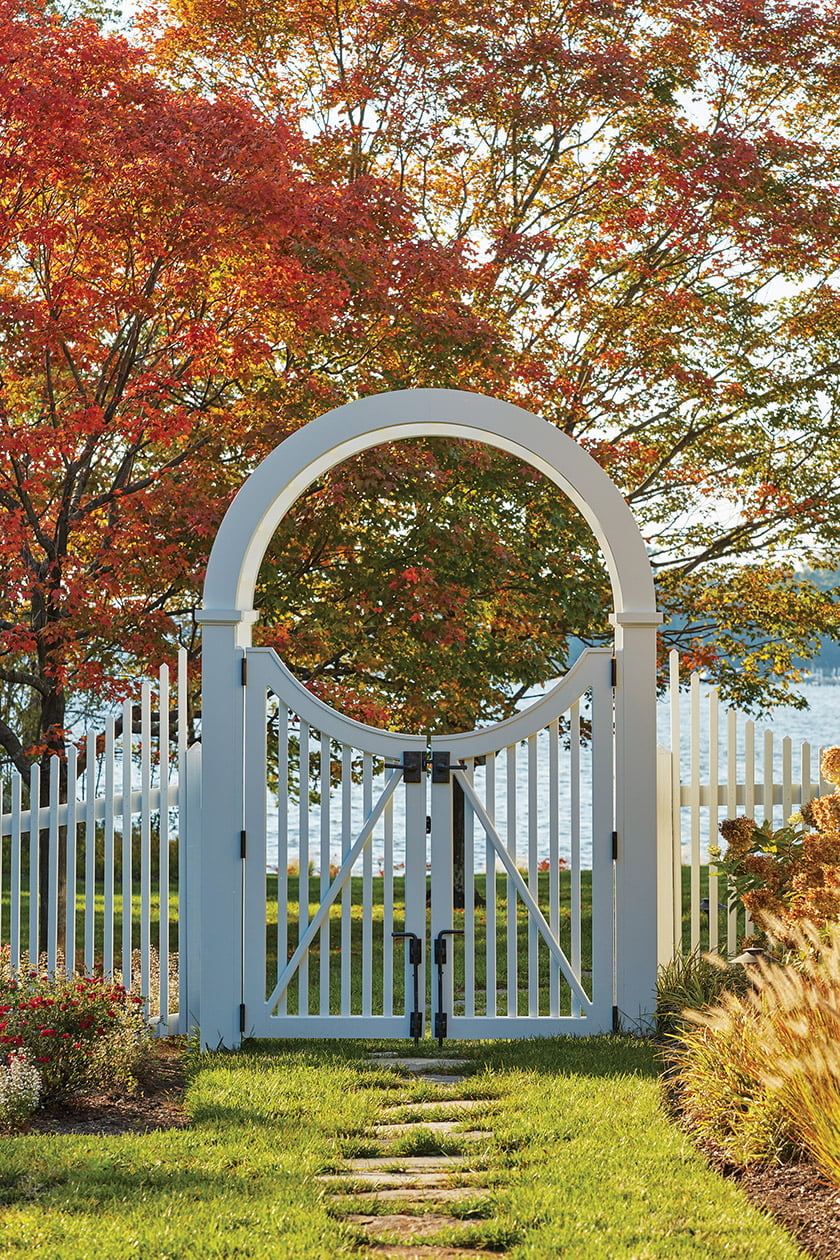 White arbor and picket fence