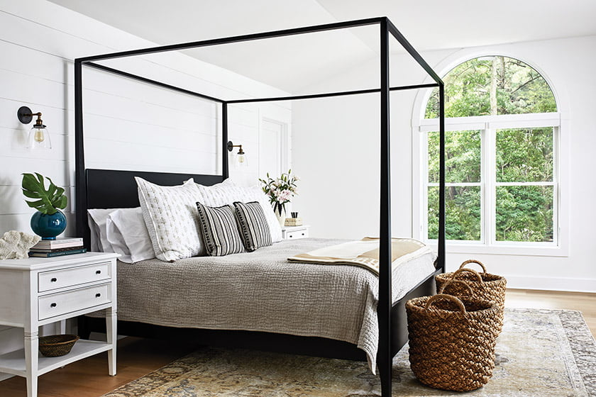 Owners suite with iron four-poster bed