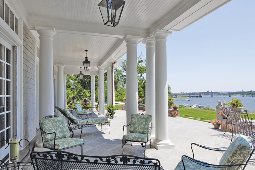 covered-terrace-with-beadboard-ceiling-and-stone-floor