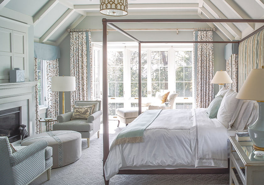 Vaulted ceiling in owners bedroom with pencil-post bed from Hickory Chair