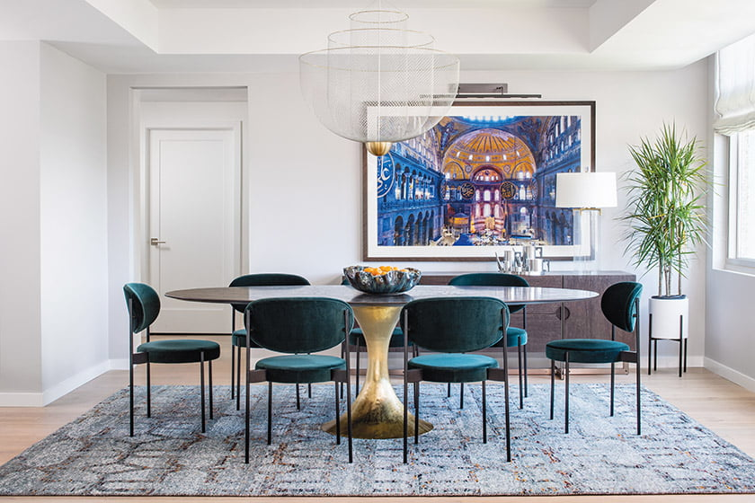 Hammered-steel base Julian Chichester dining room table and a hand-knotted, wool-and-silk rug