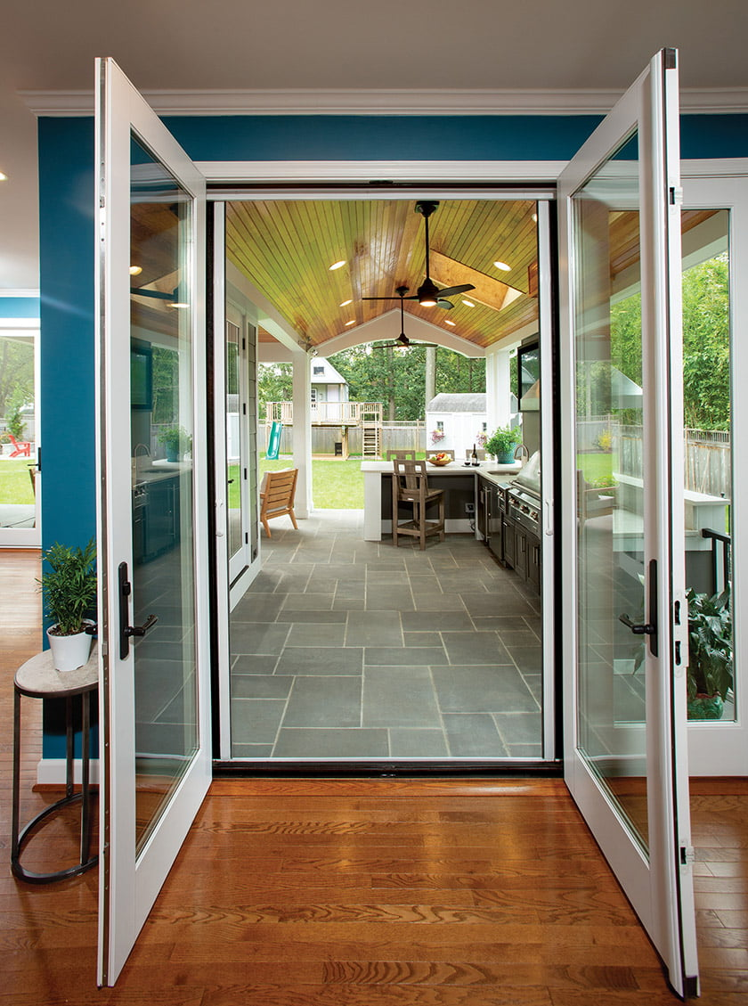 Gabled rear porch accessible through double glass doors