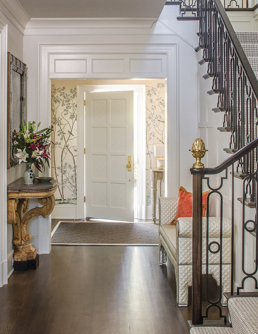 Entrance hall with modern stair-rail made with Tudoresque wrought iron